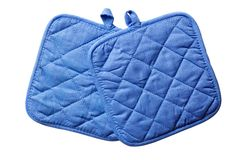 Oven gloves. Blue oven gloves isolated on white Royalty Free Stock Photos