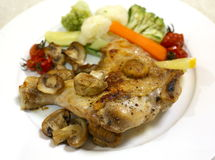 Oven grilled chicken leg dinner Stock Image