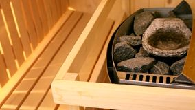 Oven with hot stones in sauna stock footage