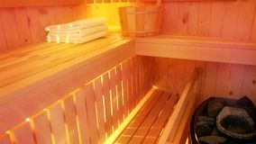 Oven with hot stones in sauna stock video footage