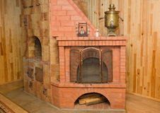 Oven in the house. It is located the oven from a red brick in the house and serves for heating Stock Photos