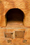 Oven in the house. It is located the oven from a red brick in the house and serves for heating Stock Photo