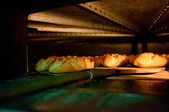 Oven inside plenty of bread Royalty Free Stock Images