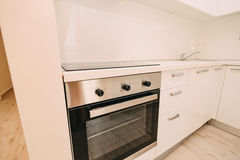 The oven in the kitchen. Stove with oven. The kitchen in the apa. Rtment Stock Images