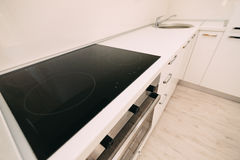The oven in the kitchen. Stove with oven. The kitchen in the apa. Rtment Stock Photo