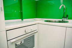 The oven in the kitchen. Stove with oven. The kitchen in the apa. Rtment Stock Photography