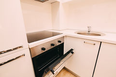 The oven in the kitchen. Stove with oven. The kitchen in the apa. Rtment Stock Image