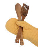 Oven Mitt Holding Wood Spoon and Fork Stock Photos