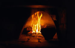 Oven open flame burn old pot abstract background natural light Royalty Free Stock Photography