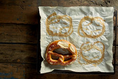 Oven paper with pretzel imprints Stock Photo