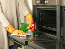 Oven polishing Royalty Free Stock Photography