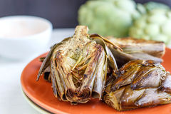 Oven Roasted Artichokes. Healthy vegetarian food - oven roasted artichokes Stock Photo