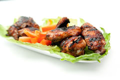 Oven roasted bbq chicken wings baked instead of fried. Oven roasted bbq chicken wings healthy baked instead of fried Royalty Free Stock Photos