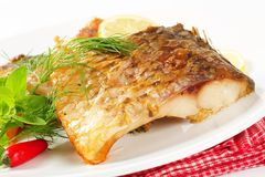 Oven roasted carp Stock Photos