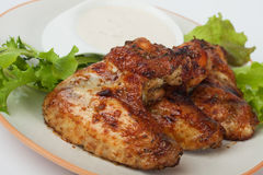 Oven roasted chicken wings. With lettuce and dipping sauce Royalty Free Stock Photos