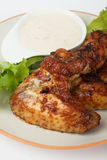 Oven roasted chicken wings. With lettuce and dipping sauce Royalty Free Stock Photography