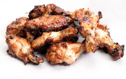 Oven roasted chicken wings. Beautiful oven roasted chicken wings with barbeque sauce Royalty Free Stock Images