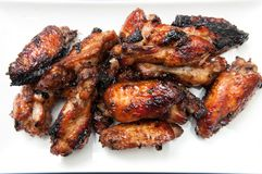 Oven roasted chicken wings. Beautiful oven roasted chicken wings with barbeque sauce Royalty Free Stock Photo