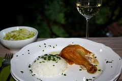 Oven roasted chicken wit basmati rice, sauce, iceberg salad stock photo