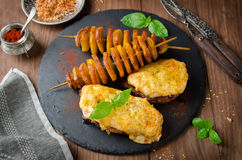 Oven roasted meat under cheese and potato kebab royalty free stock images