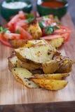 Oven roasted potato wedges Stock Photo