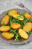 Oven Roasted Potatoes with Arugula Royalty Free Stock Image