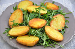 Oven Roasted Potatoes with Arugula Royalty Free Stock Photos