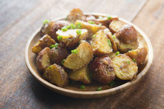 Oven roasted potatoes on plate Royalty Free Stock Photo