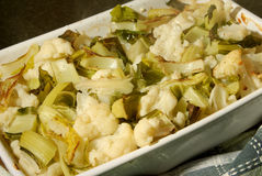 Oven roasted rustic style cauliflower. In a ceramic casserole Stock Photography