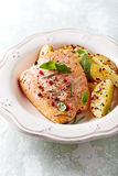 Oven-roasted salmon fillet with baked potatoes Stock Photo