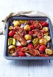 Oven-Roasted Sausages with Autumn Vegetables Royalty Free Stock Images