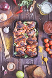 Oven-roasted spicy chicken wings on serving pan Royalty Free Stock Photos