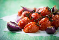 Oven roasted tomatoes and onions Royalty Free Stock Photography