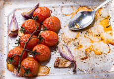 Oven roasted tomatoes and onions Stock Photography