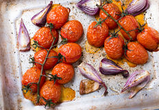 Oven roasted tomatoes and onions Stock Image