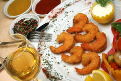 Oven shrimps. On the plate with white wine Royalty Free Stock Photography