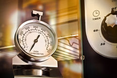 Oven Thermometer. An oven thermometer shot against oven background Stock Image