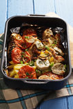 Oven tray with baked chicken with vegetables Stock Image