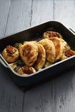 Oven tray with cordon bleu cutlets Stock Photos