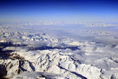 Over the Alps. Flying over the Alps airview from the cockpit window Stock Photography