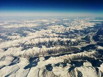 Over the Alps high in the sky Royalty Free Stock Image