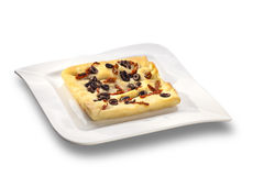 Over baked gourmet flat bread with olives and roasted tomatoes Royalty Free Stock Image