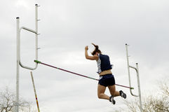 Over the Bar 2. A competitor clears the bar in the women's pole vault event during a college track meet Royalty Free Stock Photography