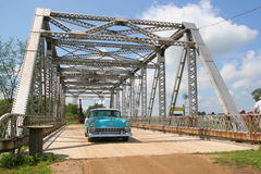 Over the Bridge. Classic Chevy Bel air driving over a vintage bridge stock photos