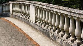 Over The Bridge. Part of a stone bridge seen at Exbury Gardens in the New Forest stock photo
