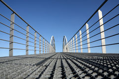 Over the bridge. Modern iron bridge, low point of view Royalty Free Stock Image