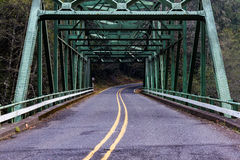 Over Bridge To The Right. Empty country road steel bridge Royalty Free Stock Images