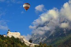 Over the castle in the clouds flying the balloon Royalty Free Stock Photos