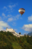 Over the castle flying giant balloon Stock Photos