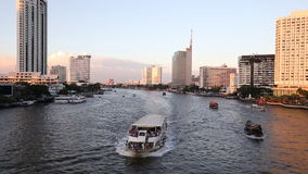 Over Chao Phraya River. And various luxury hotels and condominiums along the Chao Phraya waterfront at dusk stock video